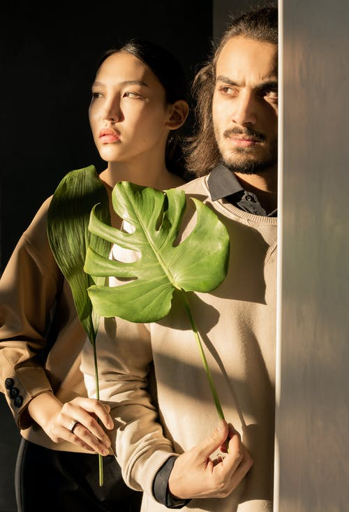 Couple Holding Green Leaves