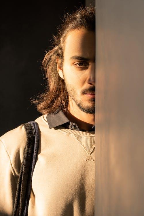 Man in Brown Sweatshirt
