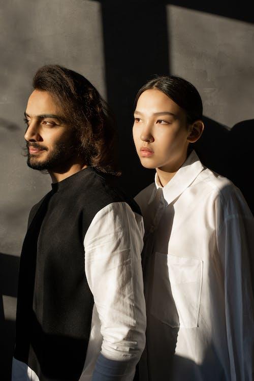 Man in Black Dress Shirt Beside Woman in White Dress