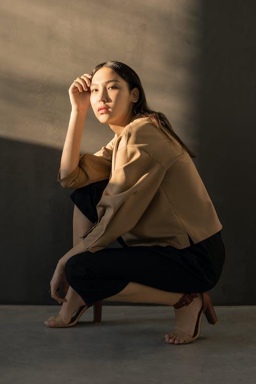 Photo Of Woman Wearing Brown Heels