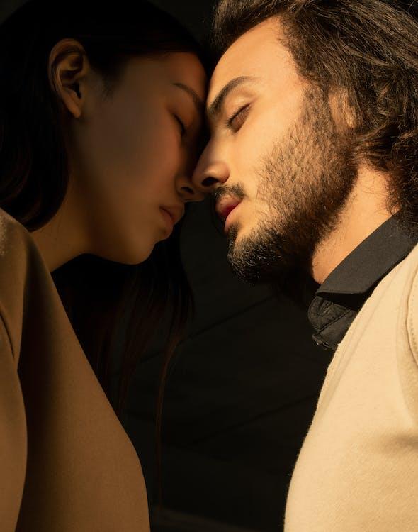 Man and Woman Closing Their Eyes