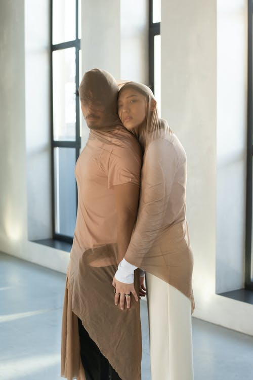 Couple Covered in Sheer Fabric