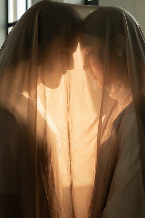 Woman and Man in Brown Sheer Fabric
