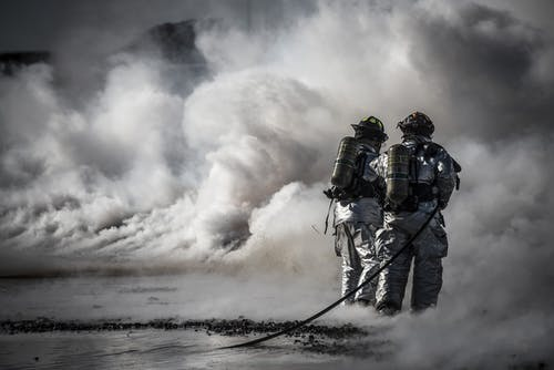 Firefighter Standing Beside Smoke