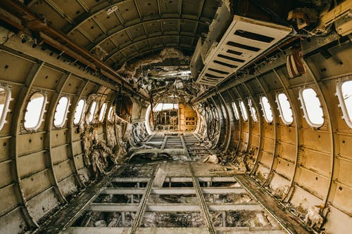 Interior of crashed aircraft cabin with windows