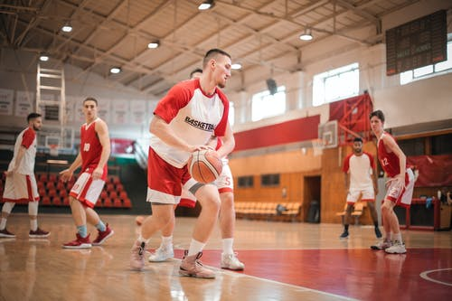 Men Playing Basketball Inside Gym