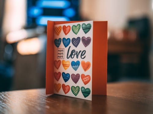 Greeting Card on  Brown Wooden Table