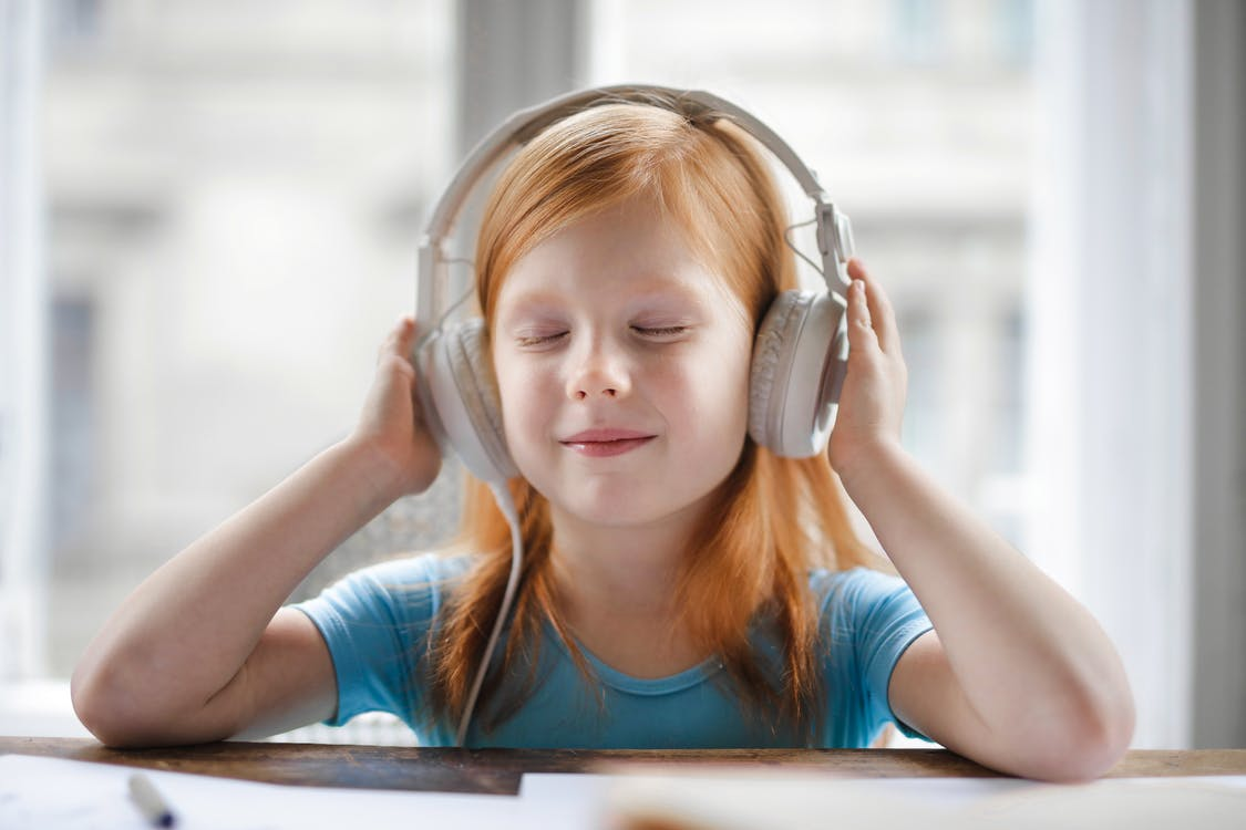 Photo of Girl Listening To Music