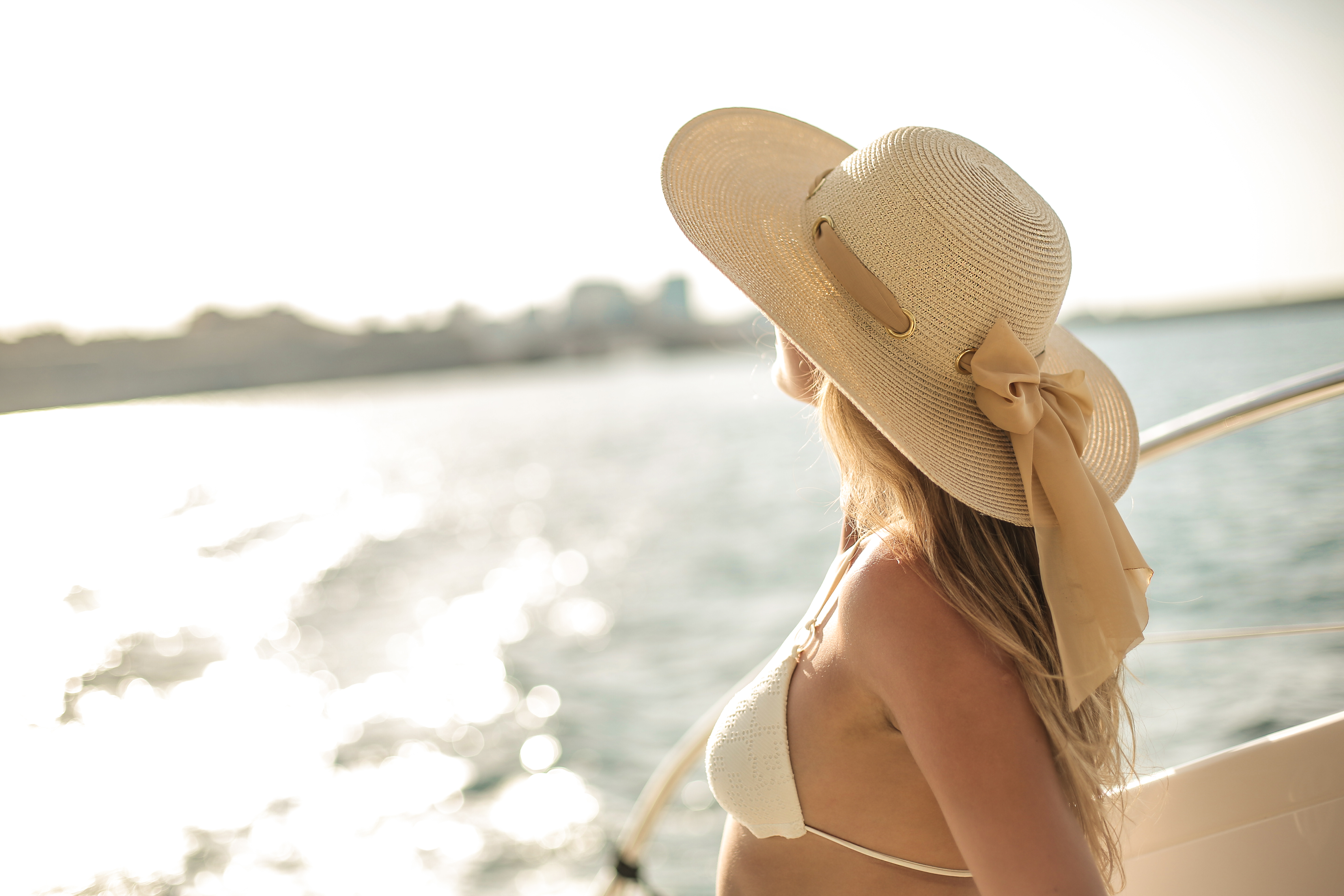 tender traveling woman on board of sailing yacht