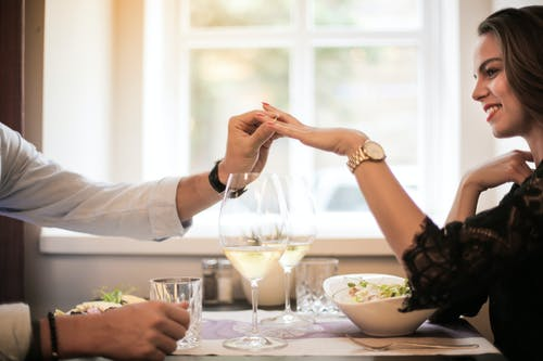 Crop man making proposal in luxurious restaurant during dinner