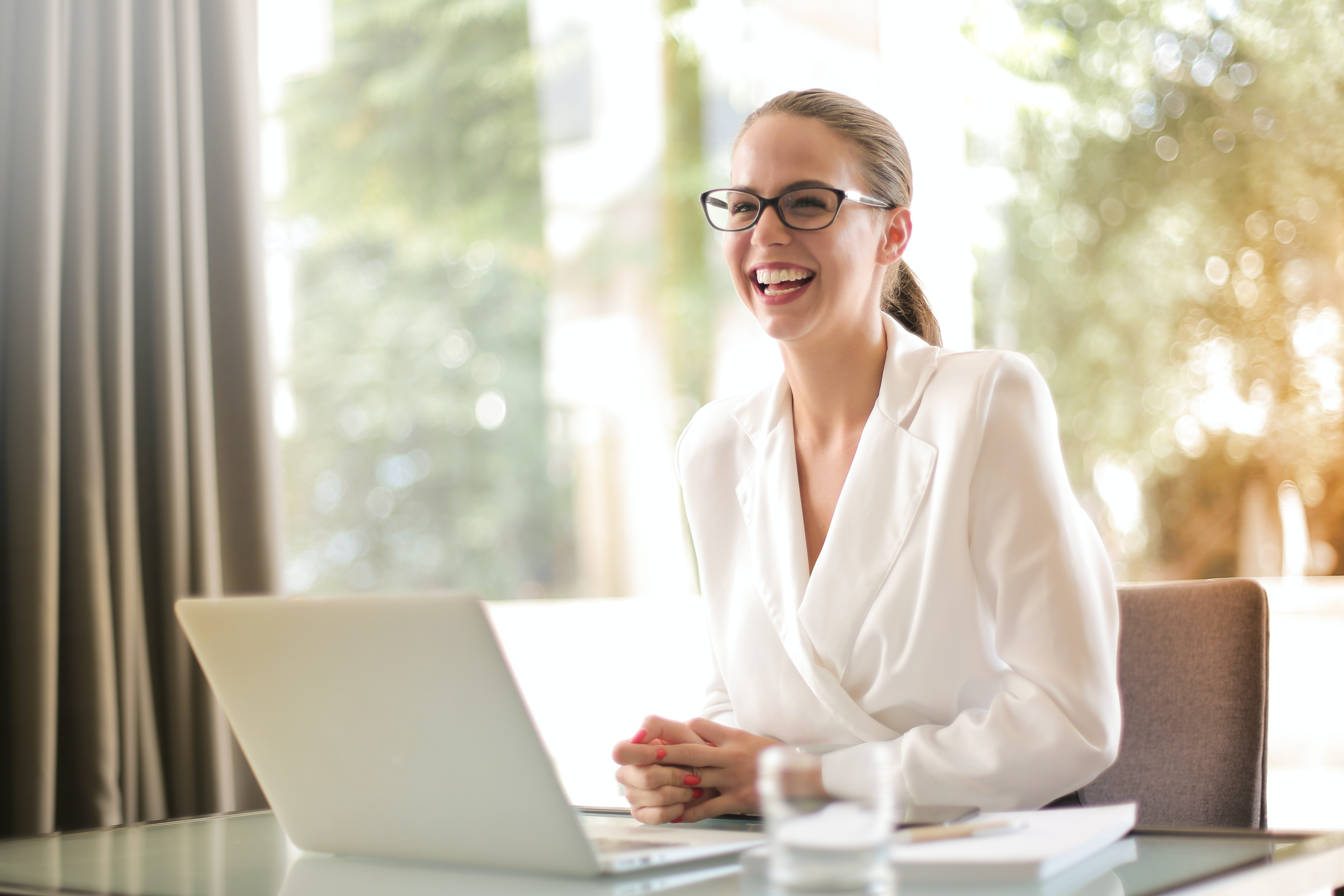 happy woman at work smiling at her desk