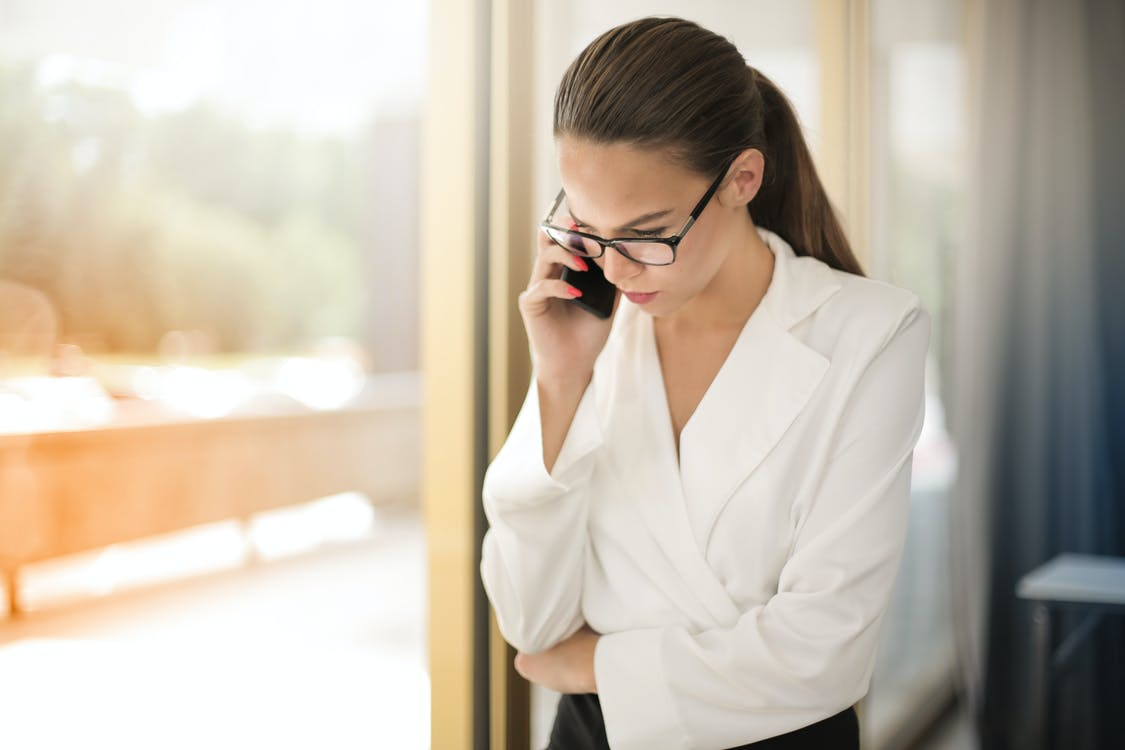 Photo of Woman Talking On Phone