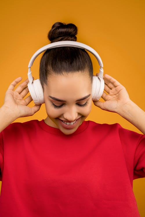 Photo of Woman Using White Headphones