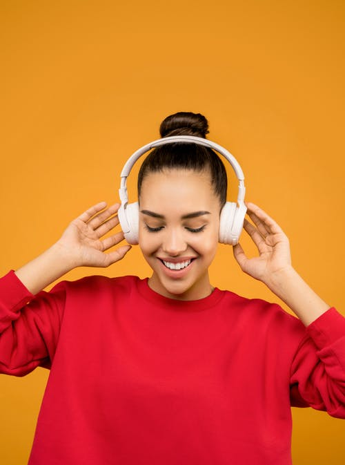 Photo of Woman Listening To Music
