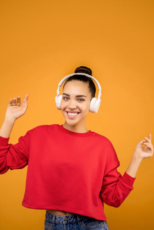 White Headphones Wear By A Young Lady