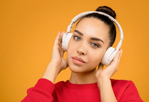 Photo of Woman Wearing White Headphones