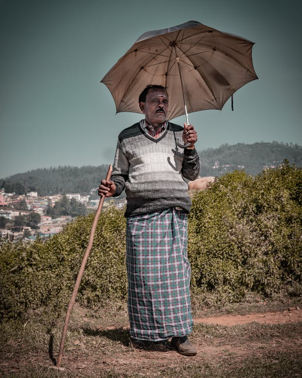 Free stock photo of man with an umbrella