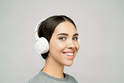 Lovely Lady Wearing a White Headphones