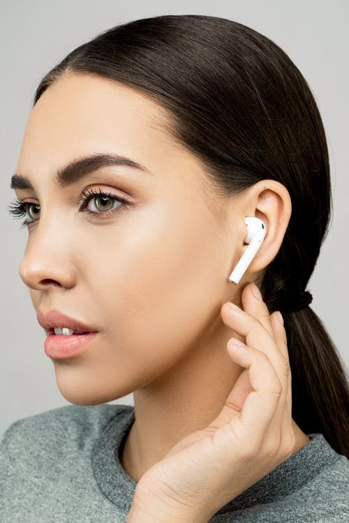 Photo of Woman Wearing Ear Pods