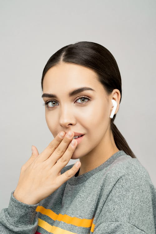 Close-Up Photo Of Woman Wearing Earpods