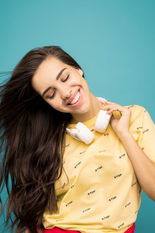 Photo Of Woman Touching Hey Headphones