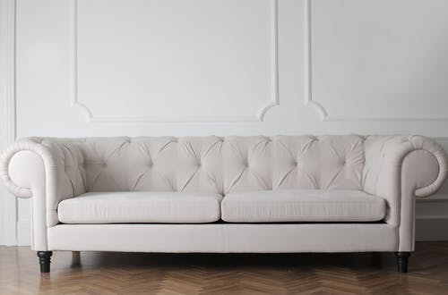 Photo Of White Couch On Wooden Floor