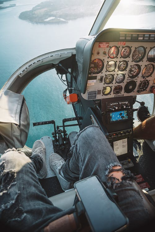 Photo Of Person Riding Helicopter