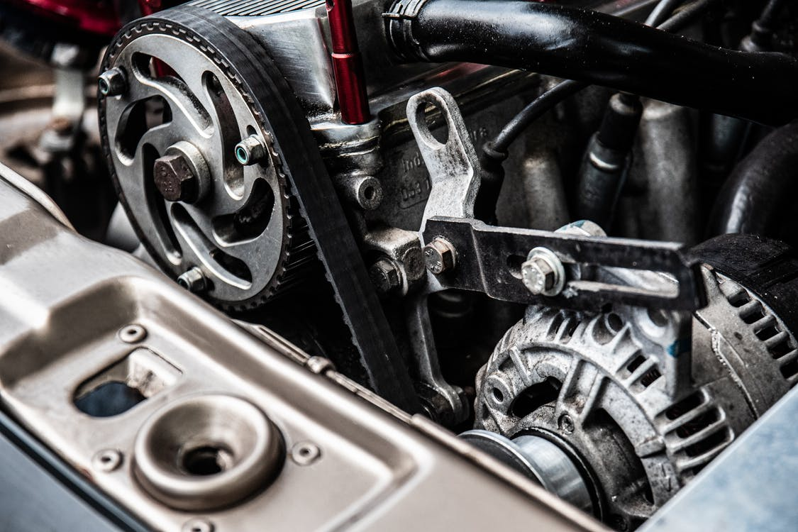 Close-up Photo of Black and Silver Car Engine