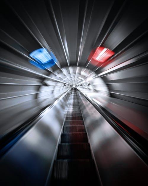 Futuristic view of escalator in gray tunnel