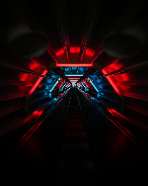 Dark urban tunnel with red and blue neon lights