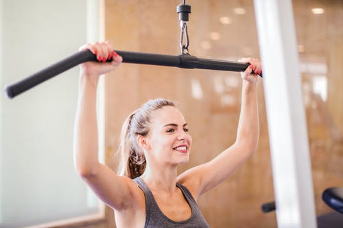 Photo Of Woman Using Gym Equipment