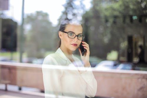 Photo Of Woman Wearing Black Eyeglasses