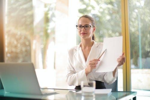 Intelligent businesswoman explaining documents in office