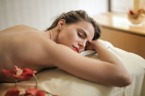 Photo Of Topless Woman Laying On Bed