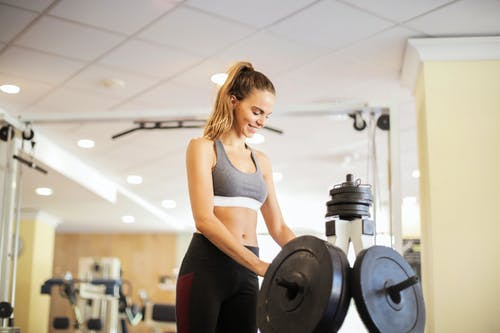 Photo Of Woman Near Dumbbells