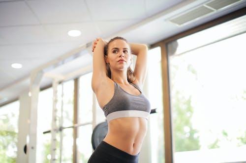 Photo Of Woman Wearing Grey Sports Bra