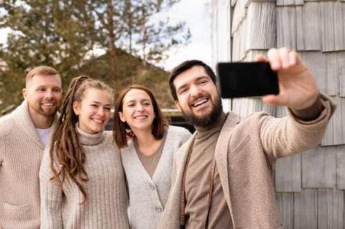 People Smiling For A Photo