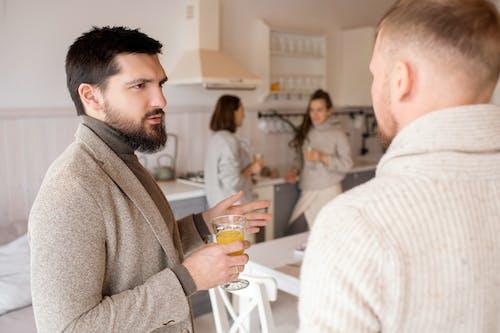 Men Talking in Kitchen