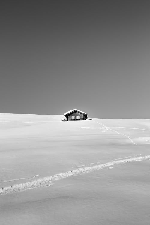 Lonesome remote cottage on snowy valley