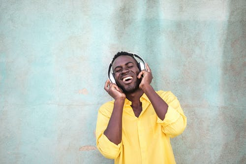 Photo Of Man Using Headphones