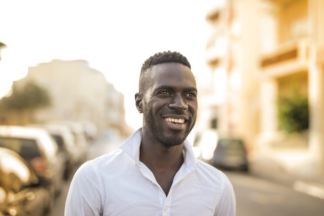 Man in White Button shirt Smiling
