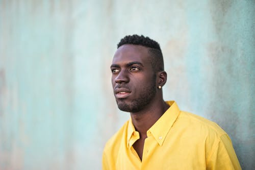 Photo Of Man Wearing Yellow Polo