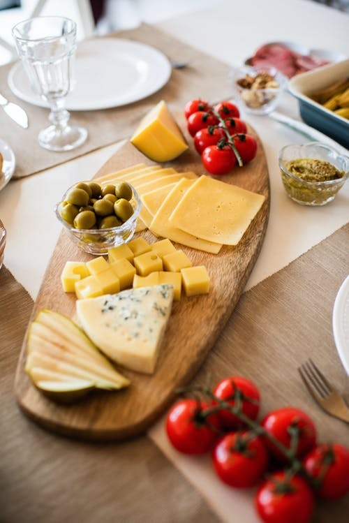 Photo Of Cheese On Wooden Tray