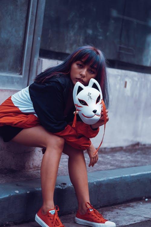 Photo Of Woman Holding Mask