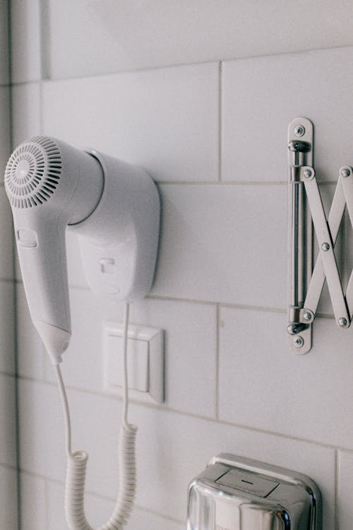 Photo Of Hairdryer Attached to The Wall