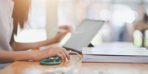 Crop doctor working on laptop in doctors office