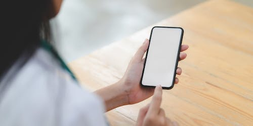 Photo Of Person Holding Smartphone