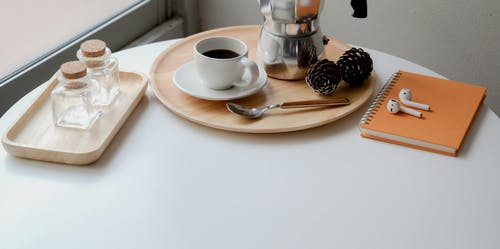 Coffee Maker and Coffee Mug On White Round Table