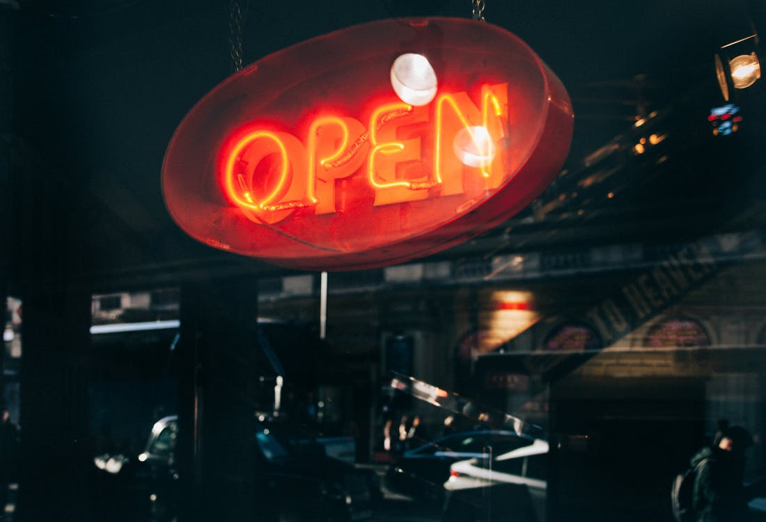 Low Light Photography of Open Neon Sign