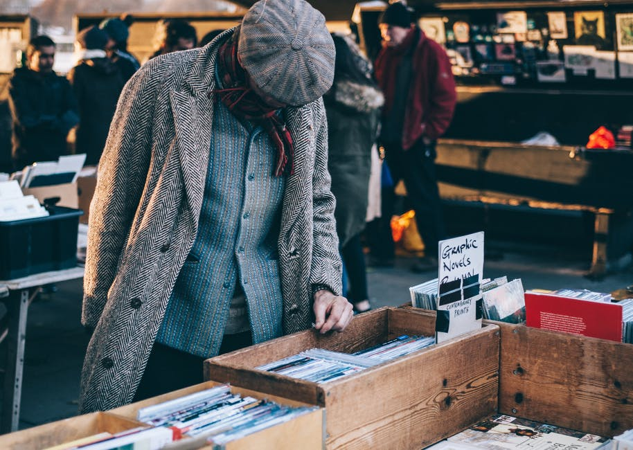 Image of a man at a record store covered in heavy thick winter clothes